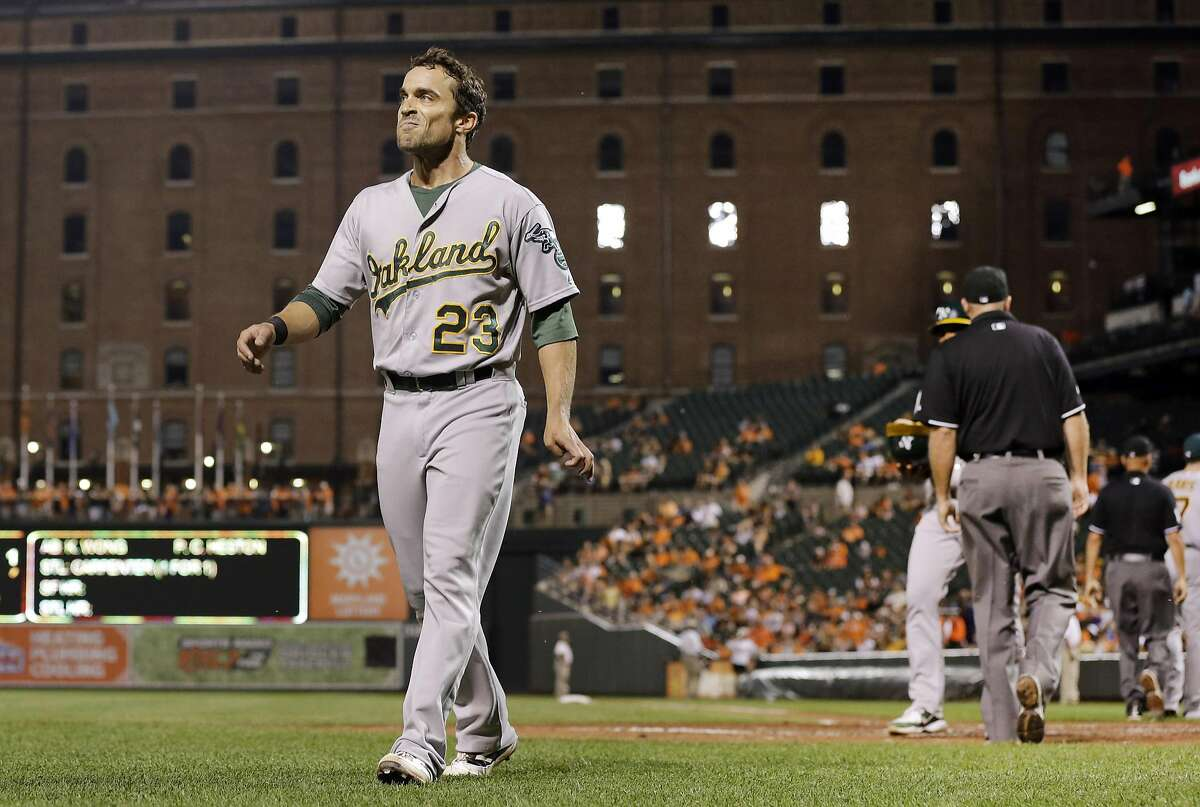 Oakland Athletics' Sam Fuld walks off the field after being ejected in the fifth inning of a baseball game against the Baltimore Orioles, Monday, Aug. 17, 2015, in Baltimore. (AP Photo/Patrick Semansky)