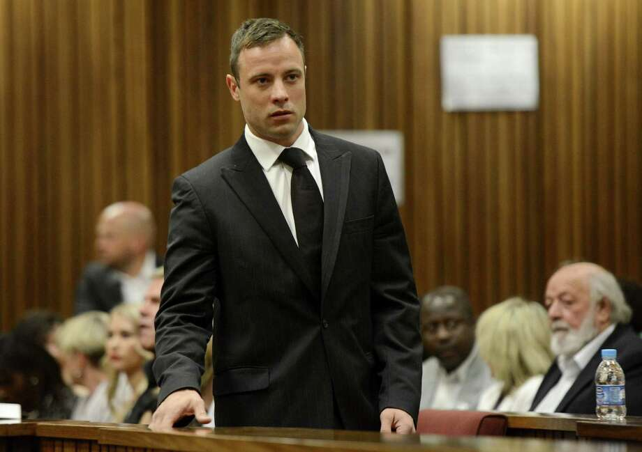 Oscar Pistorius arrives in court in Pretoria, South Africa, Tuesday, Oct. 21, 2014. Pistorius will finally learn his fate  when judge Thokozile Masipais is expected to announce the Olympic runner's sentence for killing girlfriend Reeva Steenkamp  (AP Photo/Herman Verwey, Pool) ORG XMIT: XDF102 Photo: Herman Verwey / MEDIA 24 POOL
