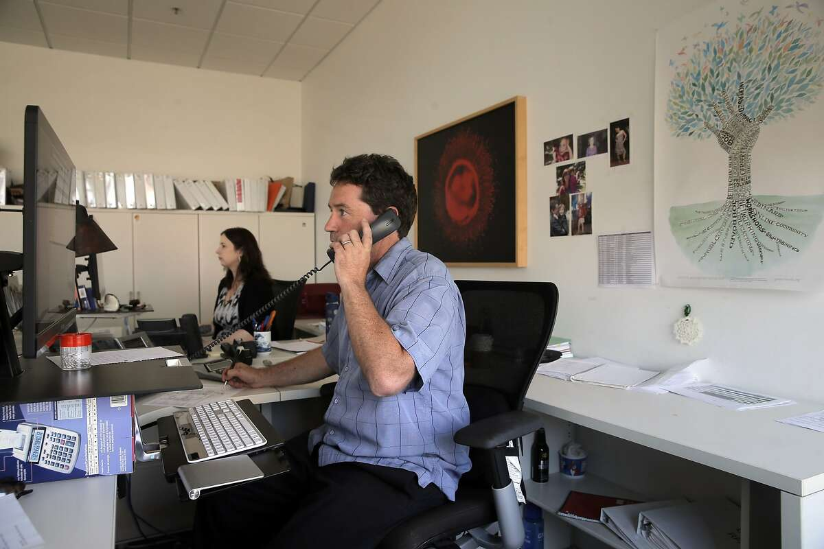 Doug Kearney, right, and Michele Carter, left, Grants Management Specialists for California's stem cell agency, the California Institute for Regenerative Medicine, in their office in San Francisco, Calif., on Monday, August 17, 2015. The CIRM will move from its current headquarters in the fall, relocating to Lake Merritt Plaza in Oakland.