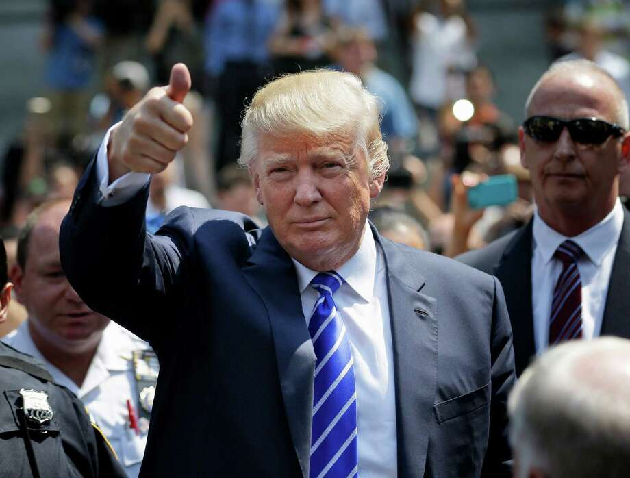 Donald Trump gives a thumbs-up as he leaves for lunch after being summoned for jury duty in New York, Monday, Aug. 17, 2015. Trump was due to report for jury duty Monday in Manhattan. The front-runner said last week before a rally in New Hampshire that he would willingly take a break from the campaign trail to answer the summons. (AP Photo/Seth Wenig) ORG XMIT: NYSW111 Photo: Seth Wenig / AP