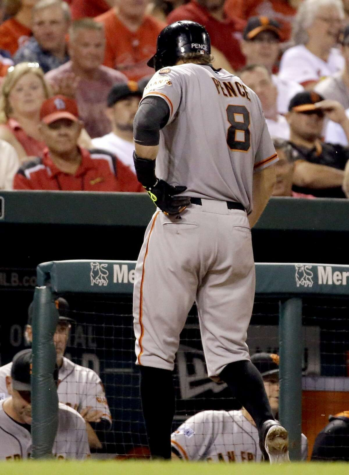 San Francisco Giants' Hunter Pence grabs his side as he heads to the dugout after flying out during the ninth inning of a baseball game against the St. Louis Cardinals Monday, Aug. 17, 2015, in St. Louis. The Cardinals won 2-1. (AP Photo/Jeff Roberson)
