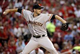 San Francisco Giants starting pitcher Chris Heston throws during the first inning of a baseball game against the St. Louis Cardinals Monday, Aug. 17, 2015, in St. Louis. (AP Photo/Jeff Roberson)