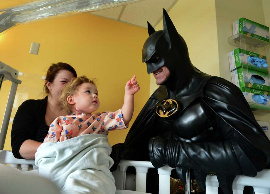 Leonard Robinson, as Batman, visits Mattie Dillon at a Charleston, W.Va., hospital in 2014. Robinson died while checking under the hood of his Batmobile. Photo: Kenny Kemp, MBO / The Charleston Gazette