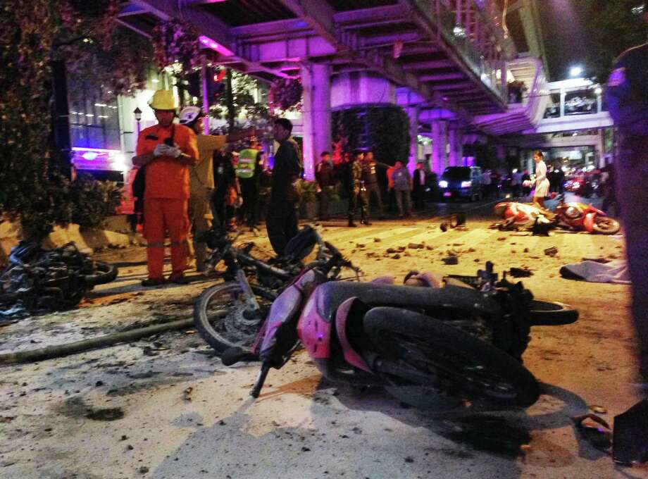 Motorcycles are strewn about after an explosion in Bangkok, Monday, Aug. 17, 2015. A large explosion rocked a central Bangkok intersection during the evening rush hour, killing a number of people and injuring others, police said. (AP Photo/Jerry Harmer) ORG XMIT: BKCD102 Photo: Jerry Harmer / AP