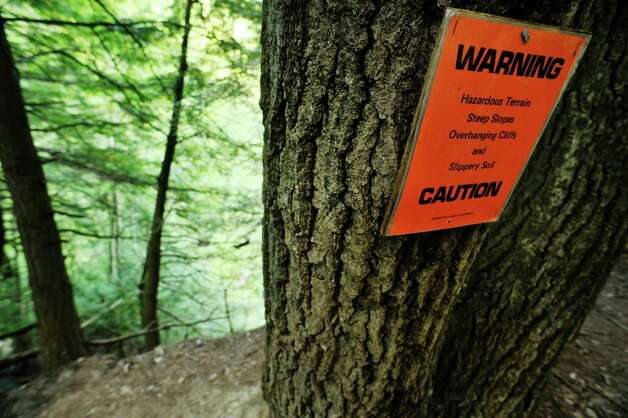 A view of a warning sign on a tree near a ledge at the Plotter Kill Preserve on Monday, Aug. 17, 2015, in Rotterdam, N.Y.  (Paul Buckowski / Times Union) Photo: PAUL BUCKOWSKI / 00033035A