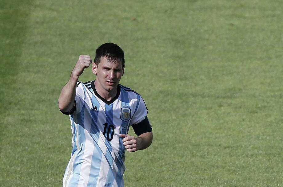 TOPSHOTS   Argentina's forward and captain Lionel Messi celebrates scoring during the Group F football match between Argentina and Iran at the Mineirao Stadium in Belo Horizonte during the 2014 FIFA World Cup in Brazil on June 21, 2014.  AFP PHOTO / ADRIAN DENNISADRIAN DENNIS/AFP/Getty Images Photo: ADRIAN DENNIS, Staff / AFP