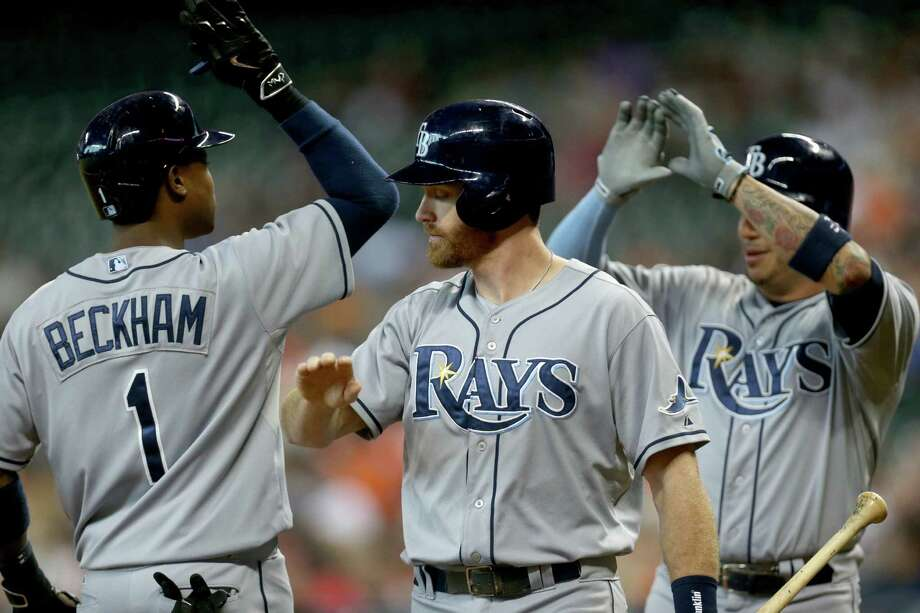 """You could have entitled this one """"End It Like Beckham"""" as Tim Beckham (1) hit a three-run homer, bringing in Logan Forsythe, center, and Asdrubal Cabrera to give the Rays a 4-0 first-inning lead that proved insurmountable. Photo: Gary Coronado, Staff / © 2015 Houston Chronicle"""