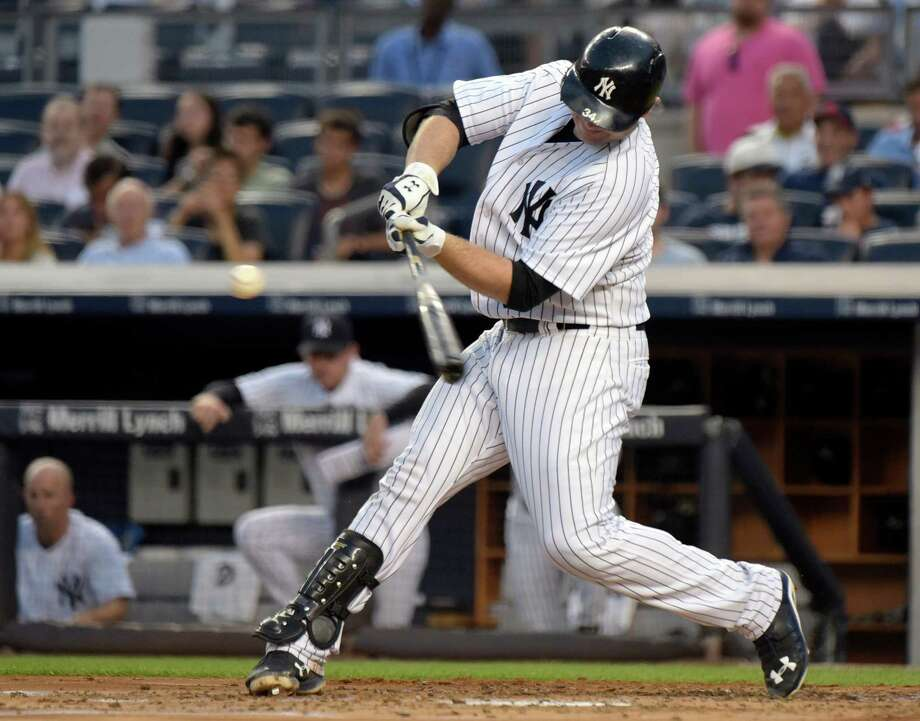 New York Yankees Brian McCann hits a three-run home run during the first inning of a baseball game against the Minnesota Twins Monday, Aug 17, 2015, at Yankee Stadium in New York. (AP Photo/Bill Kostroun) ORG XMIT: NYY111 Photo: Bill Kostroun / FR51951 AP