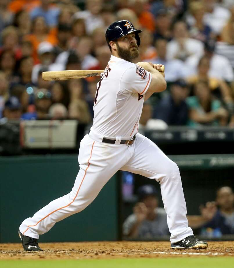 The Astros and designated hitter Evan Gattis avoided arbitration by agreeing to a one-year, $3,3 million deal Tuesday. Photo: Gary Coronado, Houston Chronicle