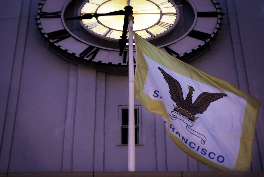 San Francisco's city flag flies over the Ferry Building in  San Francisco, Calif.,  on Monday, August 17, 2015. Roman Mars, host of the radio design show 99% Invisible — has a campaign to get a new flag for the city of San Francisco. Photo: Carlos Avila Gonzalez, The Chronicle