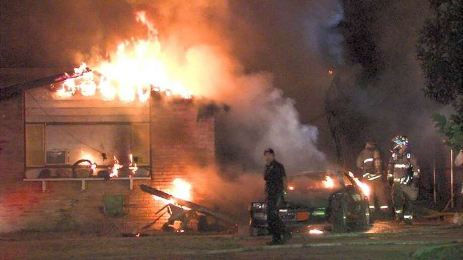 Arson investigators responded to a structure fire Tuesday morning after a home was engulfed in flames on the North Side. Photo: Courtesy Photo/Ken Branca