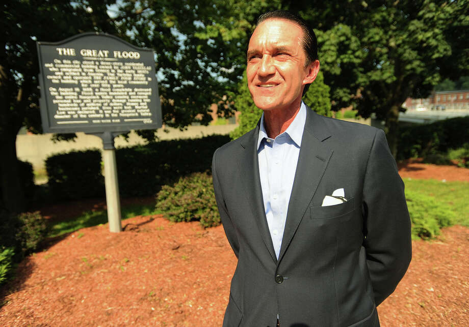 Gregory Stamos, of Woodbridge, was just an infant when his family's Ansonia business, Vartela's The Family Food Store, was washed from the banks of the Naugatuck River during the Great Flood of 1955. The location of the store, on Maple Street in Ansonia, is now known as Vartela's Park. Photo: Brian A. Pounds / Hearst Connecticut Media / Connecticut Post