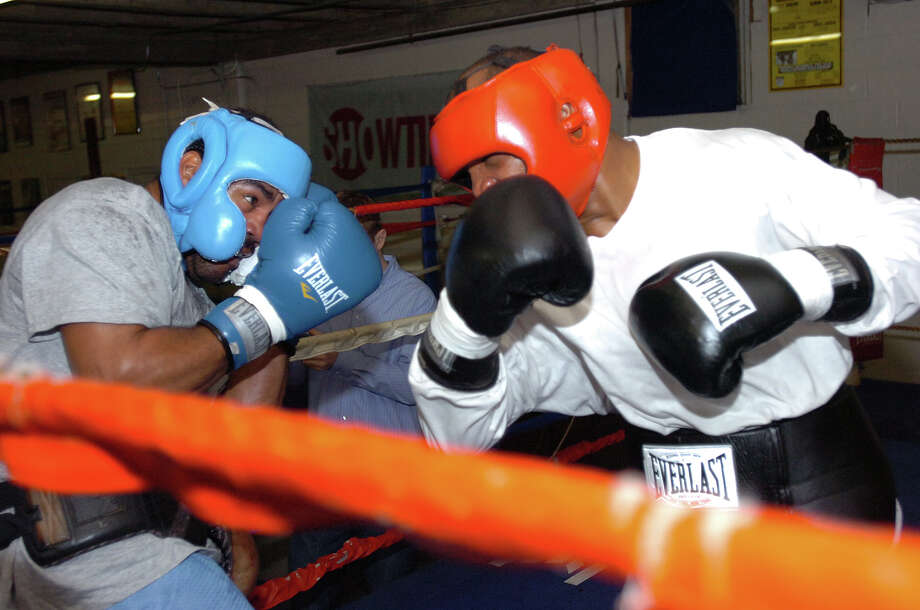 Orange native Chris Henry, right, trades blows with Felix Cora during a recent practice match in Houston during a January, 2009 workout. Guiseppe Barranco/The Enterprise / Beaumont
