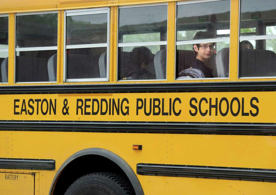 File photo of students on a bus at Joel Barlow High School on June 8. Photo: Carol Kaliff / Staff Photographer / The News-Times