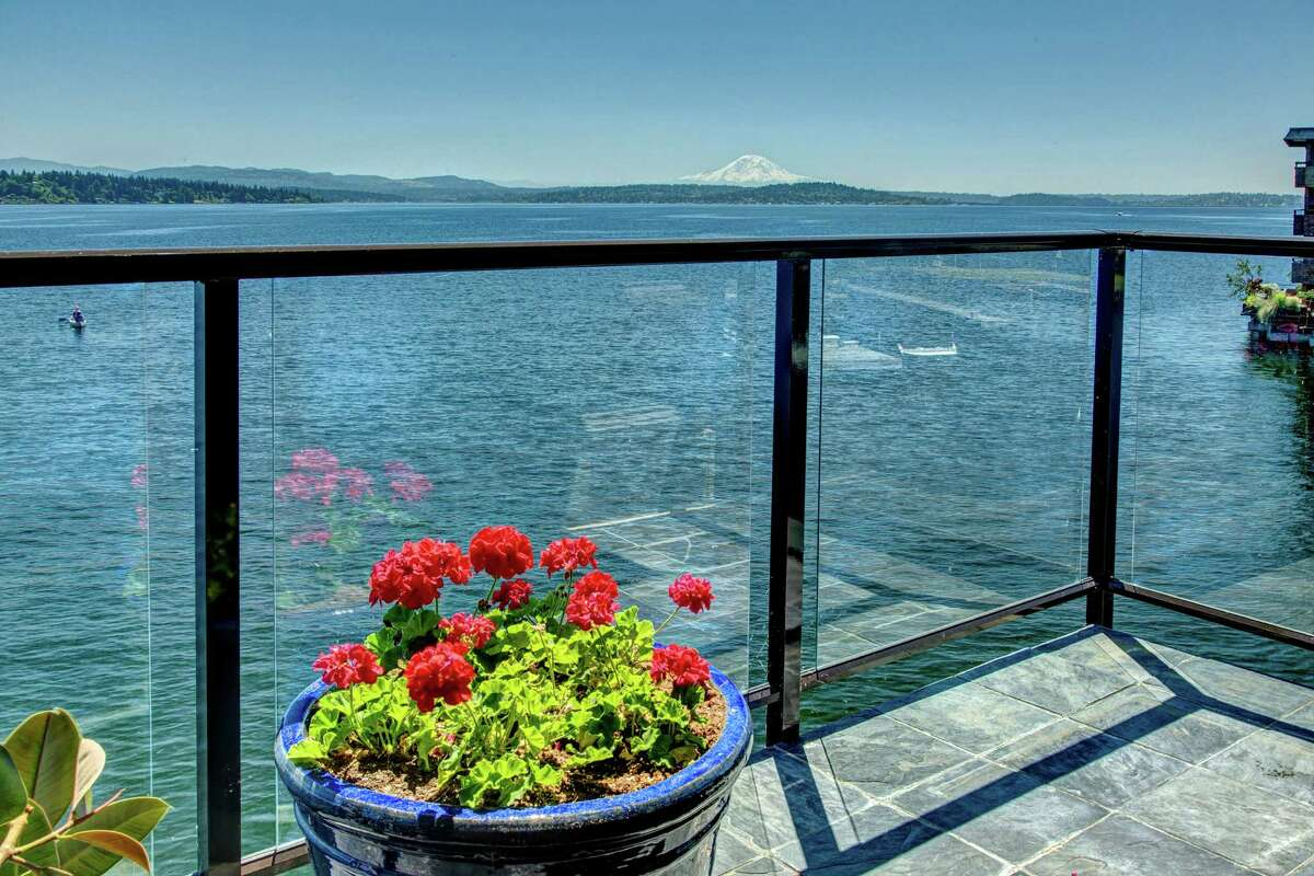 The condo is at 2360 43rd Ave. E and hard by Lake Washington. It has a deck, of course.