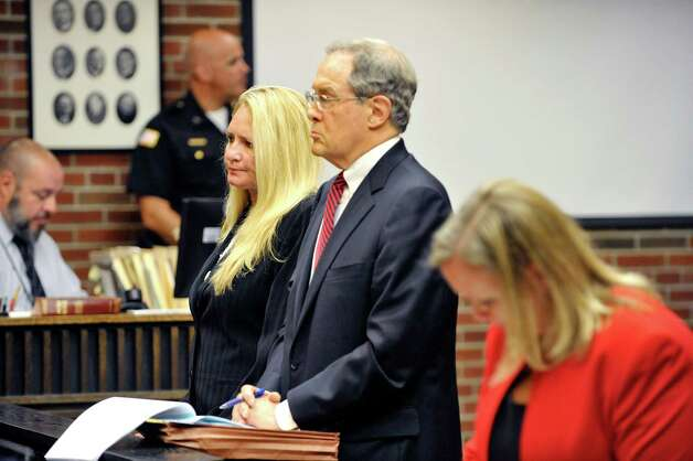 Former Halfmoon Supervisor Melinda Wormuth, left, and her attorney E. Stewart Jones, stand before Judge Matt Sypniewski in Saratoga County Court where Wormuth pleaded guilty to State charges on Tuesday, Aug. 18, 2015, in Ballston Spa, N.Y.  (Paul Buckowski / Times Union) Photo: PAUL BUCKOWSKI / 00032975A