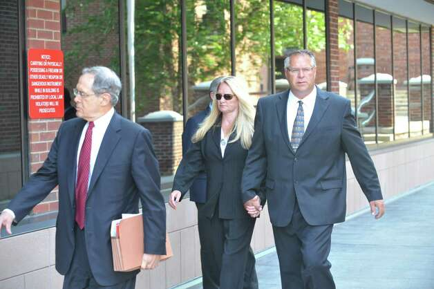 Attorney E. Stewart Jones, left, his client, Former Halfmoon Supervisor Melinda Wormuth, center, and her husband Larry Wormuth make their way into Saratoga County Court where Melinda Wormuth pleaded guilty to State charges.  (Paul Buckowski / Times Union) Photo: PAUL BUCKOWSKI / 00032975A