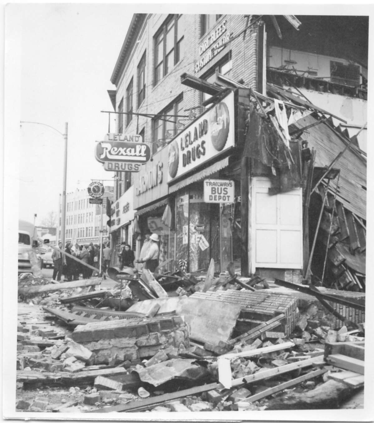 The flood of 1955 leaves destruction in its wake all over the Wall Street neighborhood of Norwalk.