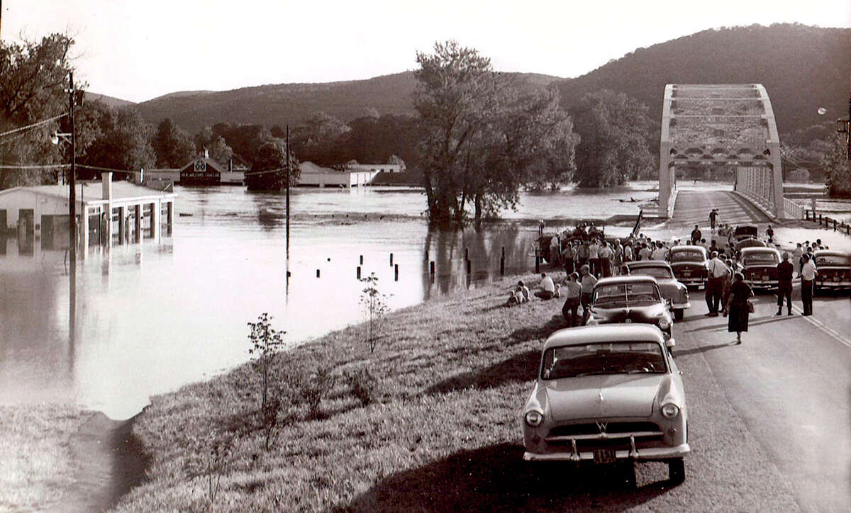 Flood of August 1955, late afternoon Bridge Street crowd near the Housatonic River, New Milford.