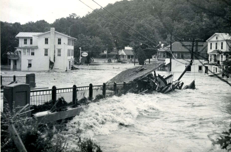 This iconic image of Washington Depot being demolished by the rampaging Shepaug River depicts the extent to which the flood of 1955 affected that typically sleepy little village center. Photo: Courtesy Of Gunn Memorial Museum, Contributed Photo / The News-Times contributed
