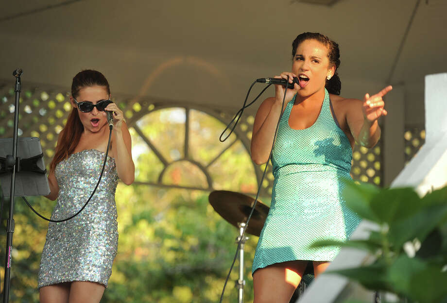 Members of The Glamour Girls Jessica Frye, left, and Lucca Troutman, perform as part of the Summer Concert Series on the Sherman Green in Fairfield, Conn. on Sunday, August 16, 2015. The next concert in the series will be the Fairfield Counts Orchestra on Wednesday at 6:30 pm. Photo: Brian A. Pounds / Hearst Connecticut Media / Connecticut Post