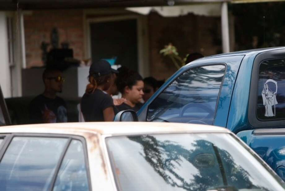 A woman and her boyfriend were shot to death late Monday night, Aug. 17, 2015 as they were sitting in a car outside her family home  in the 6100 block of Edinburg near Westover in southeast Houston. Photo: Cody Duty | Houston Chronicle