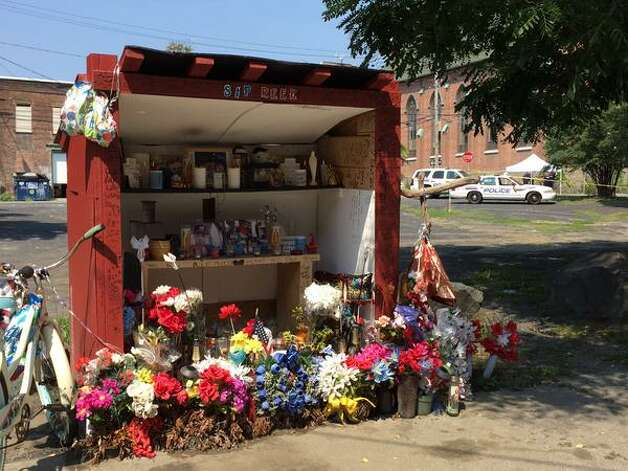 A memorial for homicide victim Tyreek Prince, 19, stands just feet from where another Aizah Carter, 19, was gunned down in Troy early Tuesday. (Lori Van Buren / Times Union)