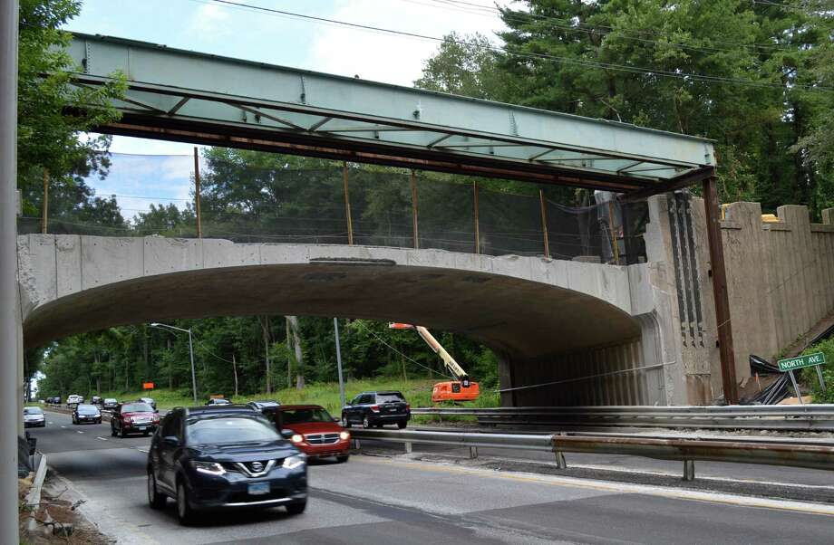 Reconstruction of the North Avenue bridge over the Merritt Parkway, complicated by the historic status of the highway and its spans, is behind its scheduled completion. Officials said Tuesday that alternate traffic will be maintained on weekdays. Photo: Jarret Liotta / For Hearst Connecticut Media / Westport News
