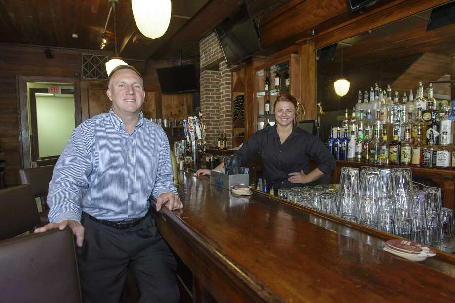 Steve Kalbaugh, owner of The M&M Restaurant & Bar, and Kirsten Ballard, bar supervisor, pose in the Galveston bar.Steve Kalbaugh, owner of The M&M Restaurant & Bar, and Kirsten Ballard, bar supervisor, pose in the Galveston bar. Photo: ÂKim Christensen, Photographer / ©Kim Christensen