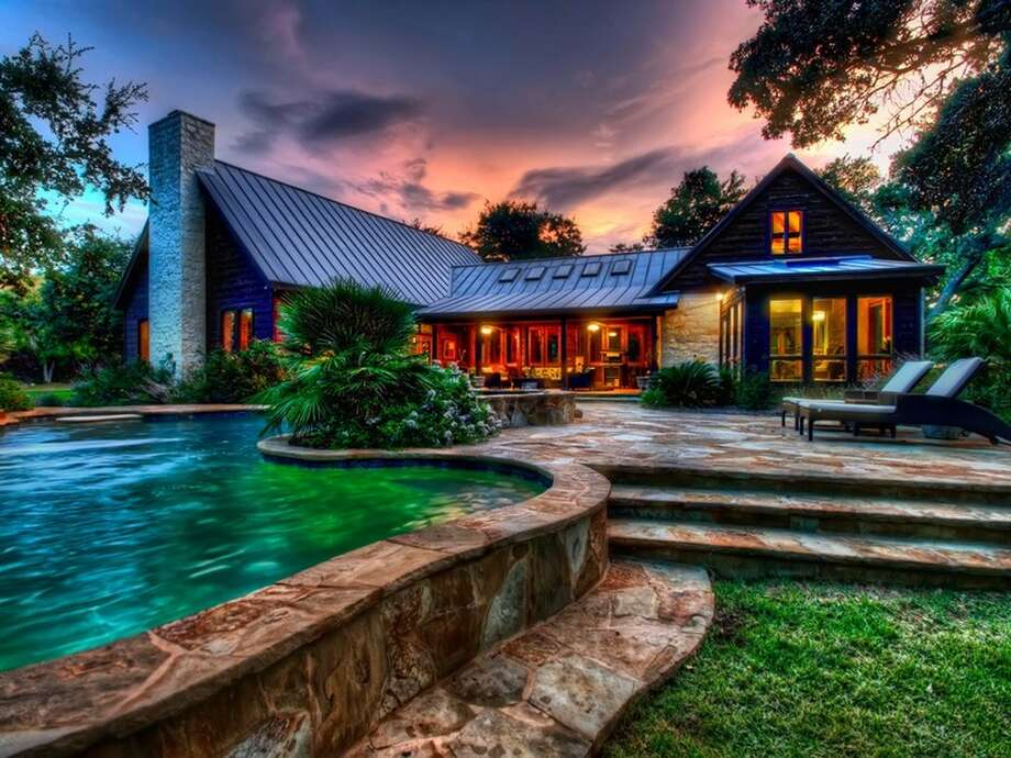 This home in the Hill Country has hit the market for $1.9 million. The three-bedroom home is located on 30 acres, and includes a pool and spa, spa-like master bathroom, a barn, a guest house and parking garage.   Photo credit: Trulia Photo: Courtesy, Trulia