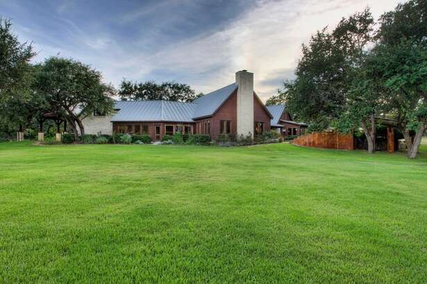 This home in the Hill Country has hit the market for $1.9 million. The three-bedroom home is located on 30 acres, and includes a pool and spa, spa-like master bathroom, a barn, a guest house and parking garage.   Photo credit: Trulia