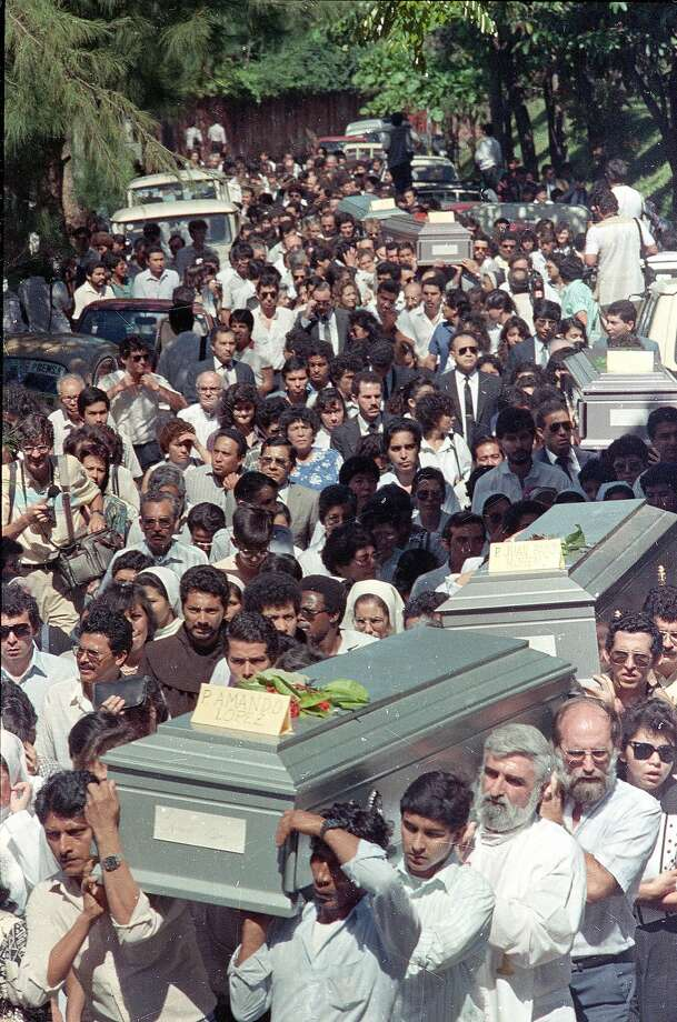 Caskets are carried during the funeral of six Jesuit priests slain by Salvadoran military, in 1989. Photo: Luis Romero, Associated Press