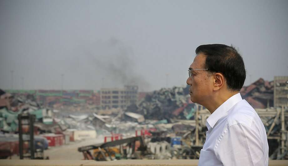 Chinese Premier Li Keqiang inspects the site in Tianjin where massive explosions killed 114 people. Photo: Str, AFP / Getty Images