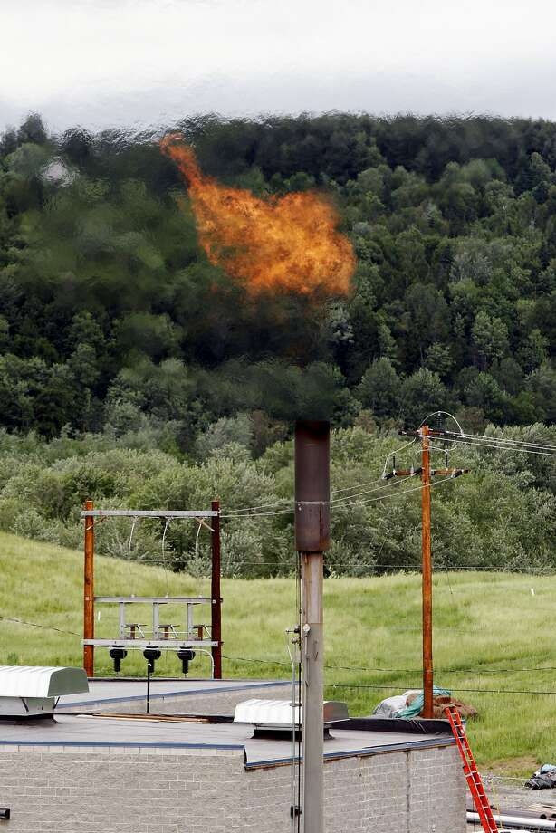 Methane gas, the key component of natural gas, burns near the Washington Electric Cooperative power plant in Coventry, Vt. Photo: Toby Talbot, Associated Press