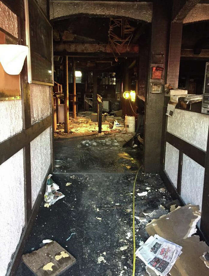A fire erupted at Dante's bar Tuesday morning near the border between the University District and the Roosevelt neighborhood of Seattle. The blaze was caused by overheated electrical wiring in the basement, according to the Seattle Fire Department. Photo: Seattle Fire Department