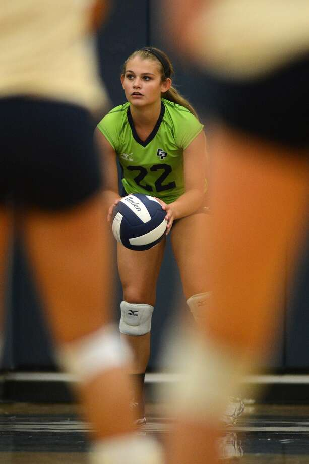 Savannah Rutledge, a 5'5 senior libero, goes to work at the serve line for College Park against Klein Collins during their season opener at KCHS on Aug. 11, 2015. (Photo by Jerry Baker/Freelance) Photo: Jerry Baker, Freelance