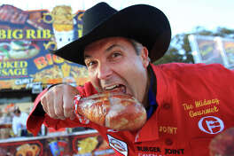 Dominic Palmieri, of Midway Gourmet, stands in front of his stand Biggys and is keeping up with the latest fried food during the Houston Livestock Show and Rodeo on Feb. 27, 2014, in Houston. ( Mayra Beltran / Houston Chronicle )