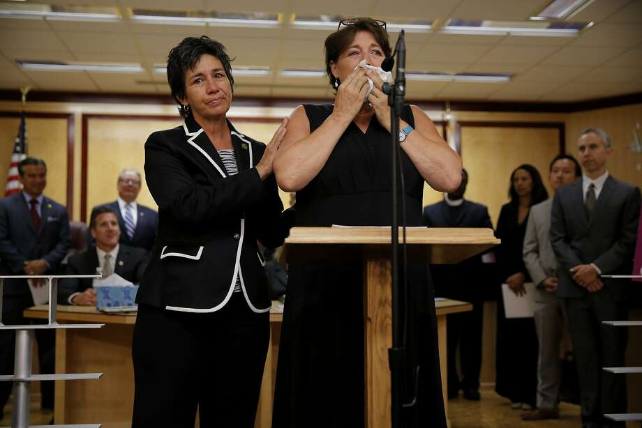 Assemblymember Susan Talamantes Eggman, D-Stockton, (left) comforts Elizabeth Wallner during a news conference on death-with-dignity legislation at the California State Capitol in Sacramento, California, on Tuesday, Aug. 18, 2015. Photo: Connor Radnovich, The Chronicle
