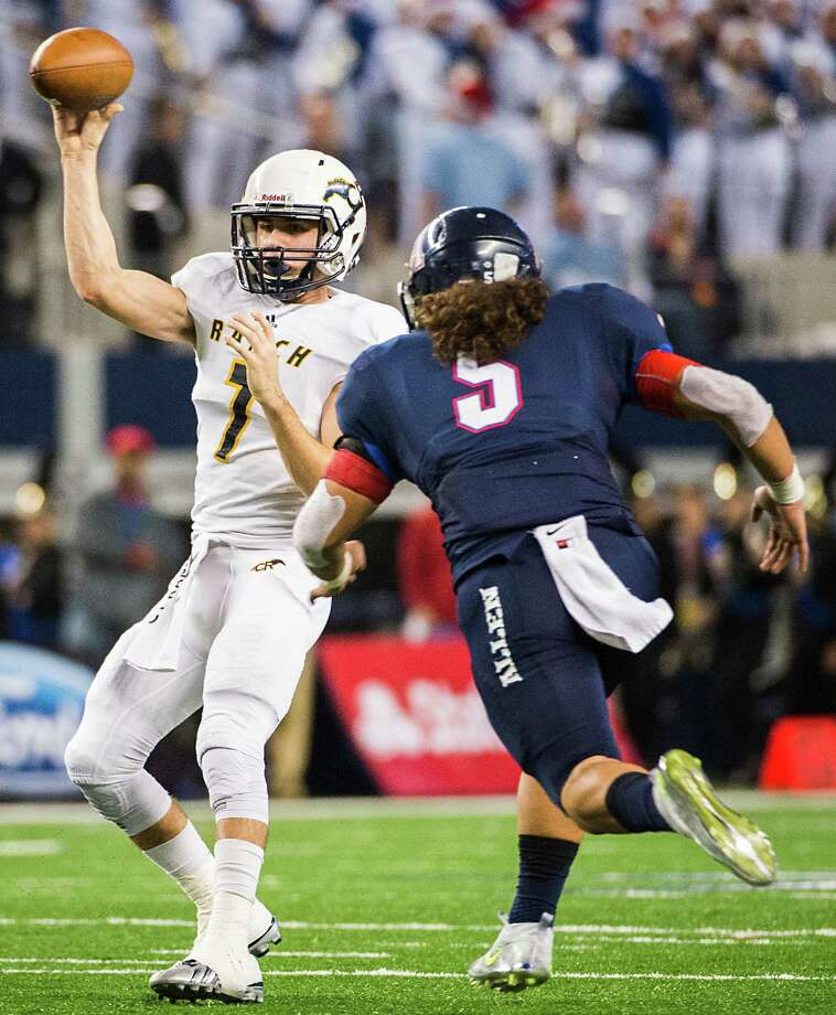 Cypress Ranch quarterback Collin Rock (7) passes under pressure from Allen Sione Tupou (5) during the first half of the Class 6A Division I state football title game at AT&T Stadium Saturday, Dec. 20, 2014, in Arlington.  ( Smiley N. Pool / Houston Chronicle ) Photo: Smiley N. Pool, Staff / Â 2014  Houston Chronicle