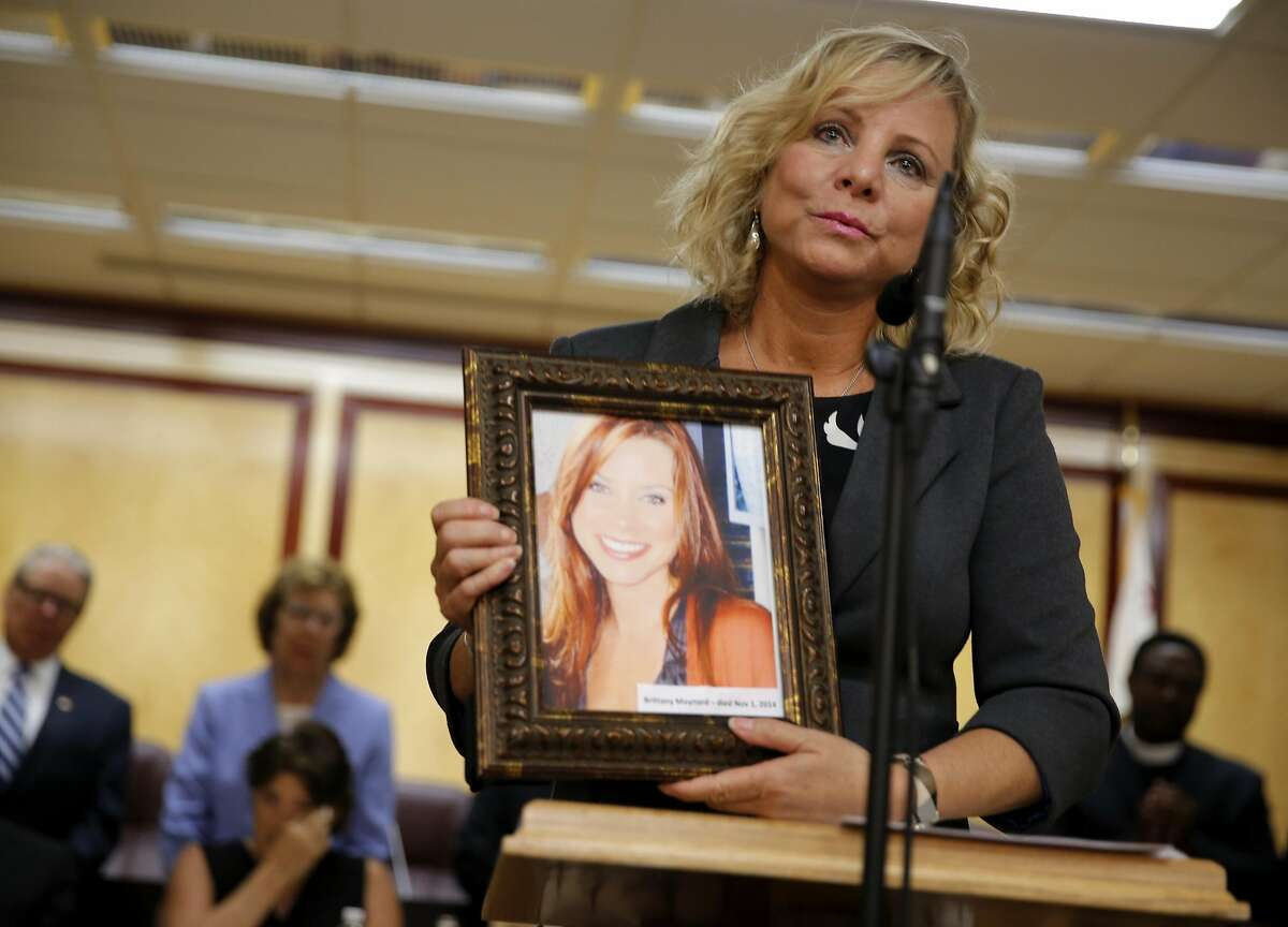 Debbie Ziegler holds a picture of her daughter Brittany Maynard while speaking at a news conference on death-with-dignity legislation at the California State Capitol in Sacramento, California, on Tuesday, Aug. 18, 2015. California Gov. Jerry Brown signed the