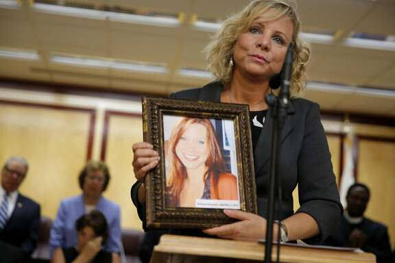 Debbie Ziegler holds a picture of her daughter Brittany Maynard while speaking at a news conference on death-with-dignity legislation at the California State Capitol in Sacramento, California, on Tuesday, Aug. 18, 2015.