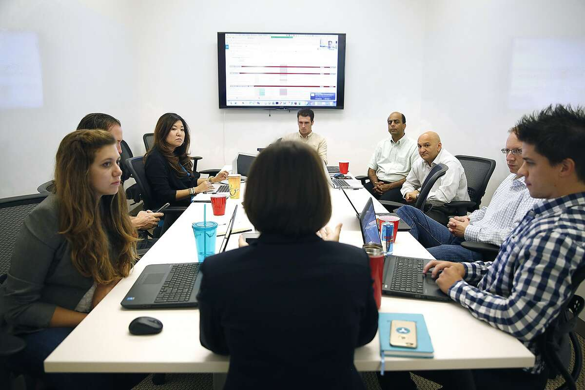 Newly appointed chief strategy officer Isabelle Guis (in front with back only seen) has a strategy meeting at Egnyte headquarters in Mountain View, Calif., on Tuesday, August 18, 2015.