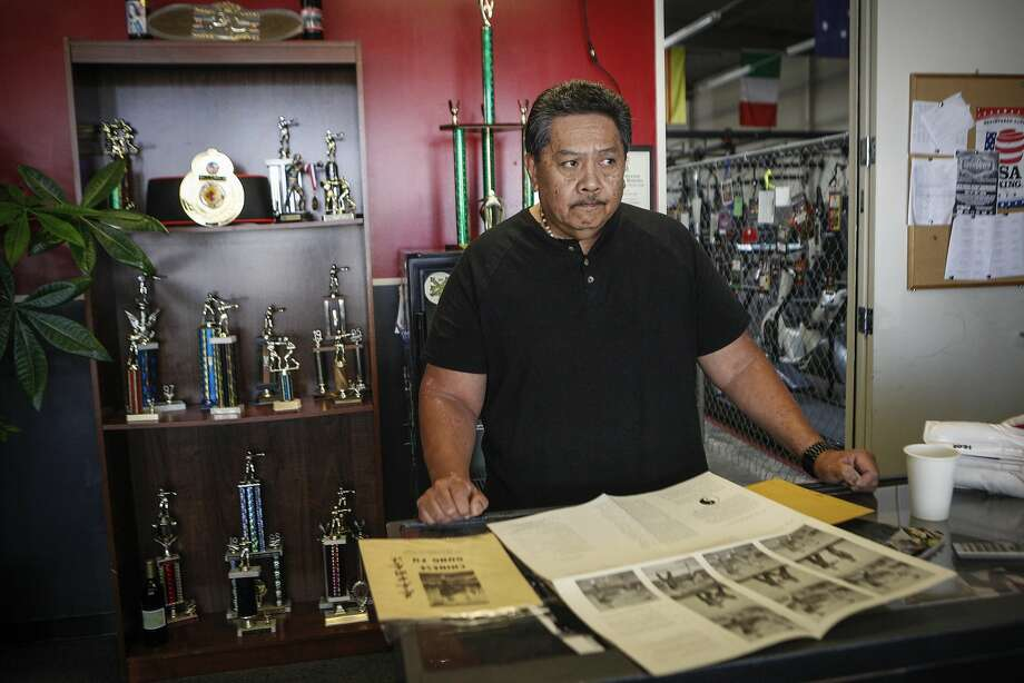 Gary Cagaanan, who trained under Bruce Lee in 1969 in Oakland, displays a gung fu booklet from Lee's school at the Kennel Boxing Gym in San Leandro. Photo: Loren Elliott, The Chronicle