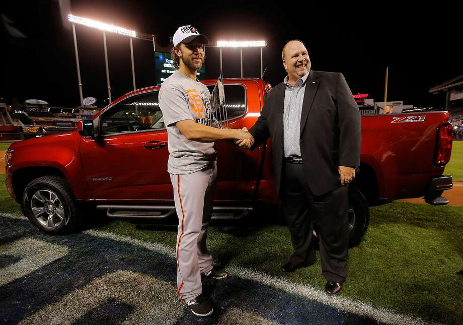 "Madison Bumgarner gets his World Series MVP truck from ""Chevy Guy"" Rikk Wilde after Game 7 in Kansas City, Mo. Photo: Doug Pensinger, Getty Images"