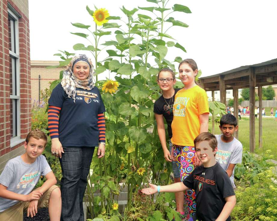 """Grants from the Katy Independent School District Education Foundation sparked creation of a garden and outdoor learning area at Griffin Elementary School. The idea for the garden came from Griffin fifth-grade teacher, Samira Hassan, second from left. """"This program definitely would not have been achievable without the Katy education foundation,"""" Hassan said.     Grants from the Katy Independent School District Education Foundation sparked creation of a garden and outdoor learning area at Griffin Elementary School. The idea for the garden came from Griffin fifth-grade teacher, Samira Hassan, second from left. """"This program definitely would not have been achievable without the Katy education foundation,"""" Hassan said. Photo: Eddy Matchette, Freelance / Freelance"""
