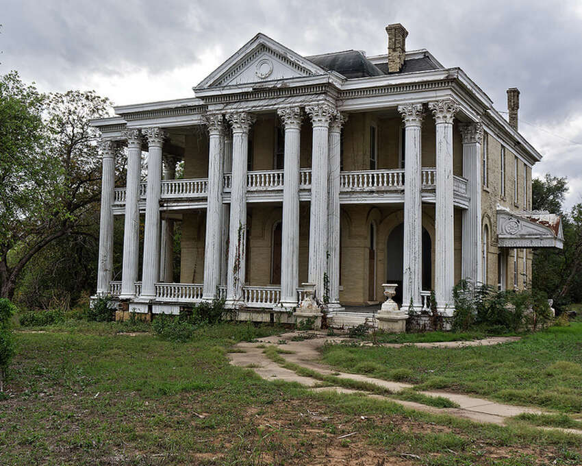 Eerie homes around Texas This abandoned mansion in Gonzales could be haunted for two reasons. First, just the facade of the house is eerie, yet some people call it