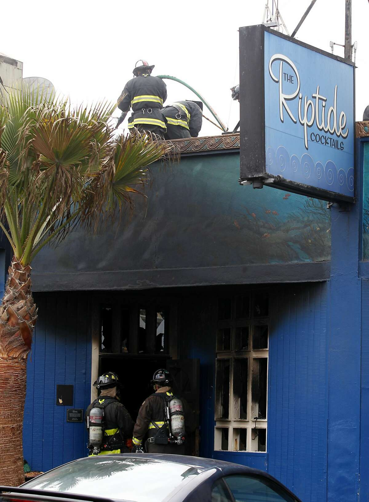Firefighters battle smoke at the Riptide Bar on Taraval Street on Tuesday, August 18, 2015 in San Francisco, Calif.