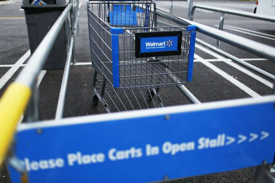 MIAMI, FL - AUGUST 18:  A Walmart cart is seen on August 18, 2015 in Miami, Florida. Walmart announced today that earnings fell in the second quarter due to currency fluctuations and the retailer's investment in employee wages and training.  (Photo by Joe Raedle/Getty Images) Photo: Joe Raedle, Getty Images