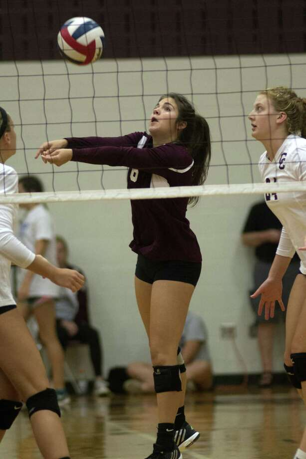 Clear Creek 5'6 senior defensive specialist Olivia Rigby, center, makes a play against Plano West during their championship semifinal matchup at the 2015 Adidas Texas Volleyball Invitational at Pearland High School on Saturday, August 15, 2015. (Photo by Jerry Baker/Freelance) Photo: Jerry Baker, Freelance