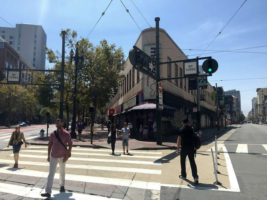 Stretch of storefronts on 900 block of Market Street will be demolished to make room for new hotel and residences. Among those being displaced is a federally funded UCSF study of an experimental Hepatitis C vaccine using Tenderloin intravenous drug users. Photo: M&r, Andrew Ross, SF Chronicle